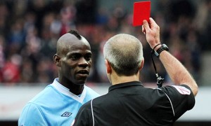Mario Balotelli is shown a red card during Manchester City's defeat to Arsenal last April